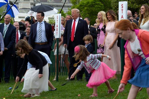 President Donald Trump and first lady Melania Trump watch an Easter Egg Roll race on the South Lawn of the White House April 17, 2017, during the annual White House Easter Egg Roll. (AP Photo/Susan Walsh)