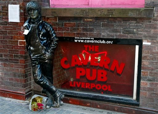 A note and flowers left at a statue of John Lennon outside the Cavern Pub in Mathew Street, Liverpool, England, Wednesday Dec. 8, 2010. Beatles fans will mark the 30th anniversary of John Lennon's death.