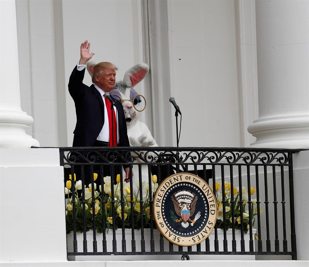 President Donald Trump accompanied by the Eastern bunny, waves from the Truman Balcony of the White House in Washington, Monday, April, 17, 2017 during the annual White House Easter Egg Roll. (AP Photo/Carolyn Kaster)