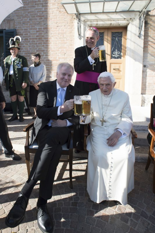 Pope Emeritus Benedict XVI makes a toast with Bavarian Prime Minister Horst Seehofer, on the occasion of a party for his 90th birthday, at the Vatican Monday, April 17, 2017.