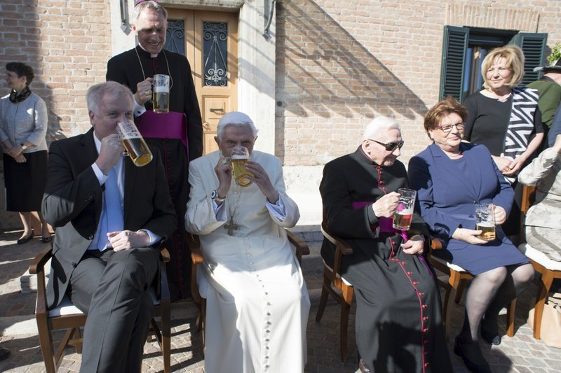 From left, Bavarian Prime Minister Horst Seehofer, Pope Emeritus Benedict XVI and his brother Georg sit on the occasion of a party for Benedict's 90th birthday, at the Vatican Monday, April 17, 2017.