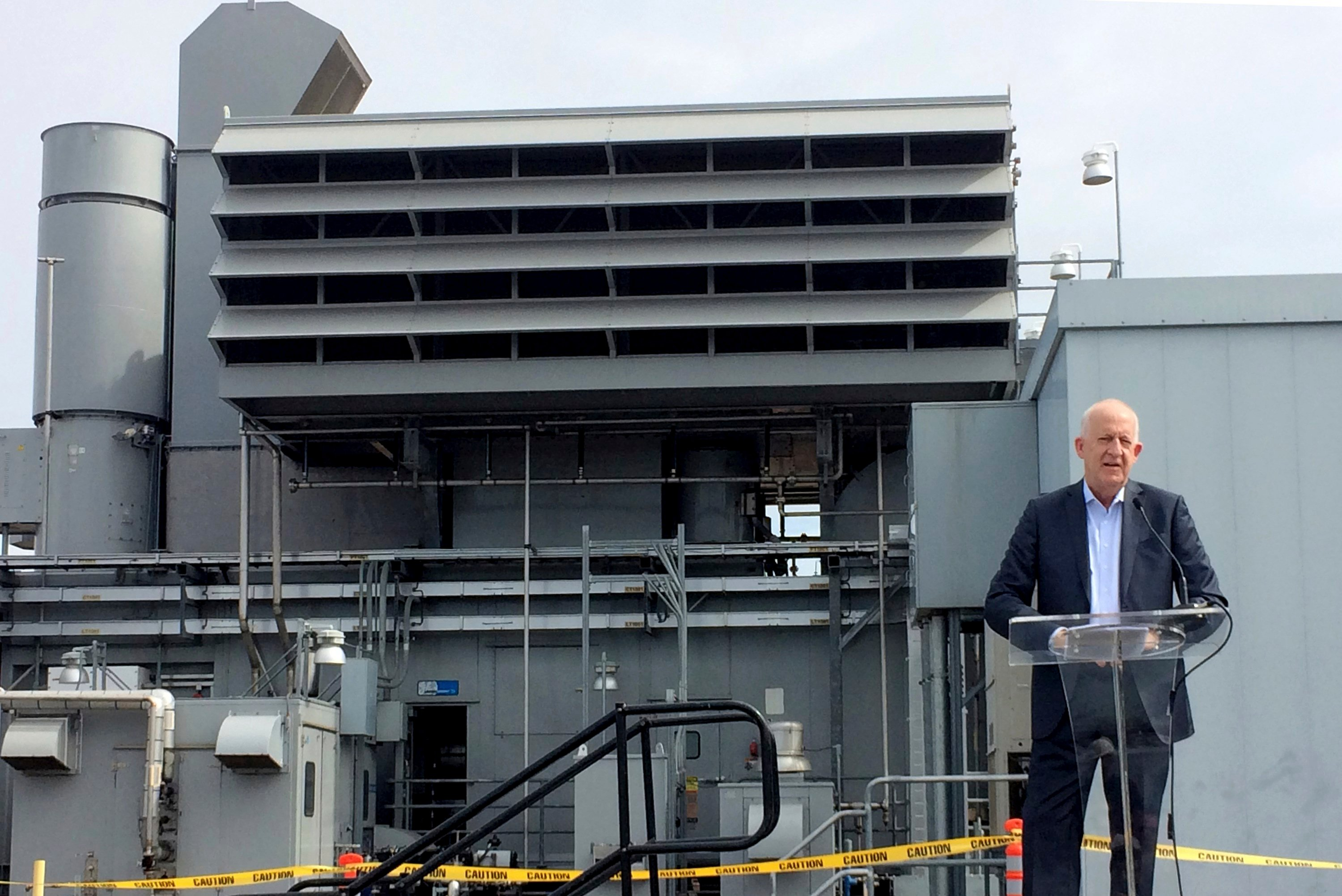 Nichols said the twin systems that went online March 30 operate somewhat like a hybrid car, drawing first on the battery, then switching over to the gas turbine if power demands spike. (AP Photo/Christopher Weber)