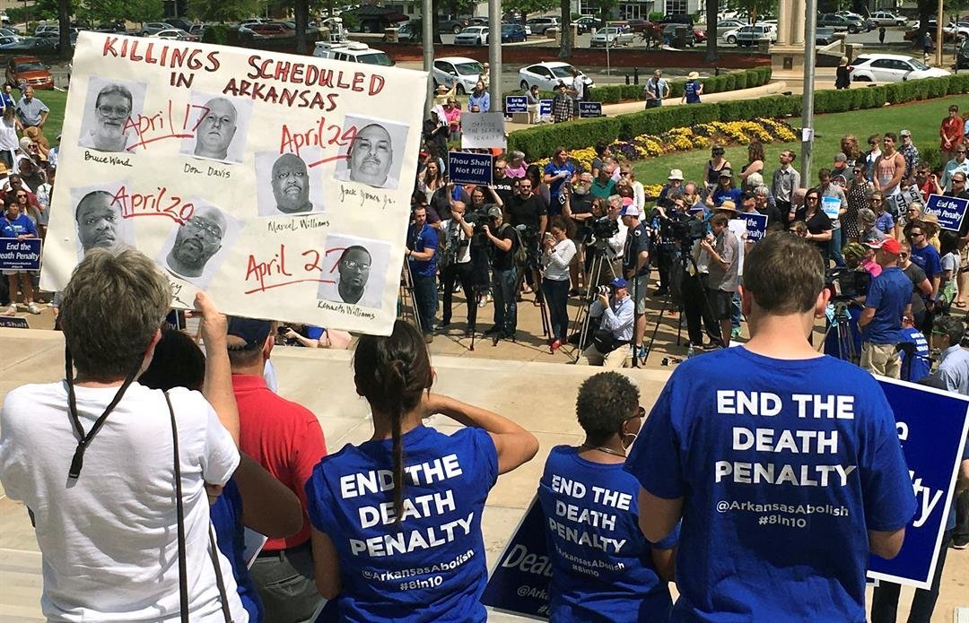 Protesters gather outside the state Capitol building on Friday, April 14, 2017, in Little Rock, Ark., to voice their opposition to Arkansas' seven upcoming executions. (AP Photo/Kelly P. Kissel)