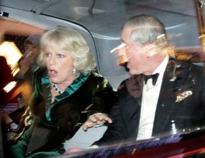 Britain's Prince Charles and Camilla, Duchess of Cornwall, react as their car is attacked by angry protesters in London, Thursday, Dec. 9, 2010.