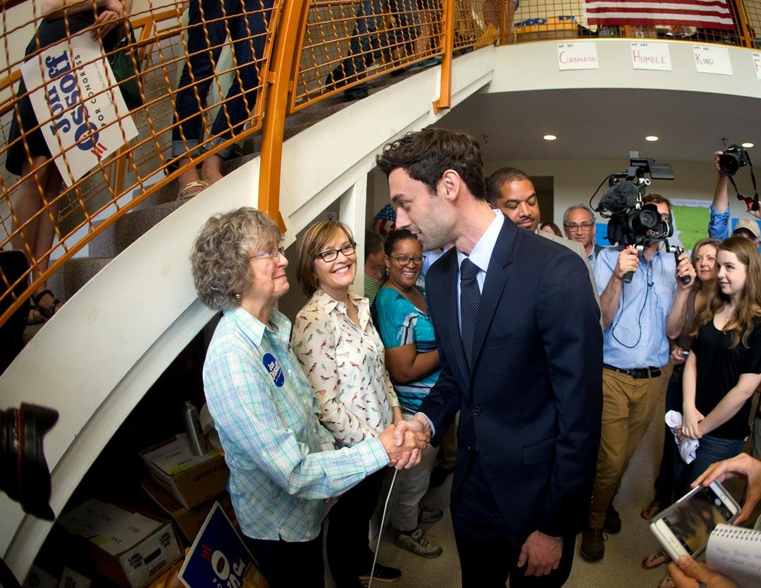 Democratic candidate for Georgia's Sixth Congressional seat Jon Ossoff greets supporters at a campaign field office Tuesday, April 18, 2017, in Marietta. (AP Photo/John Bazemore)