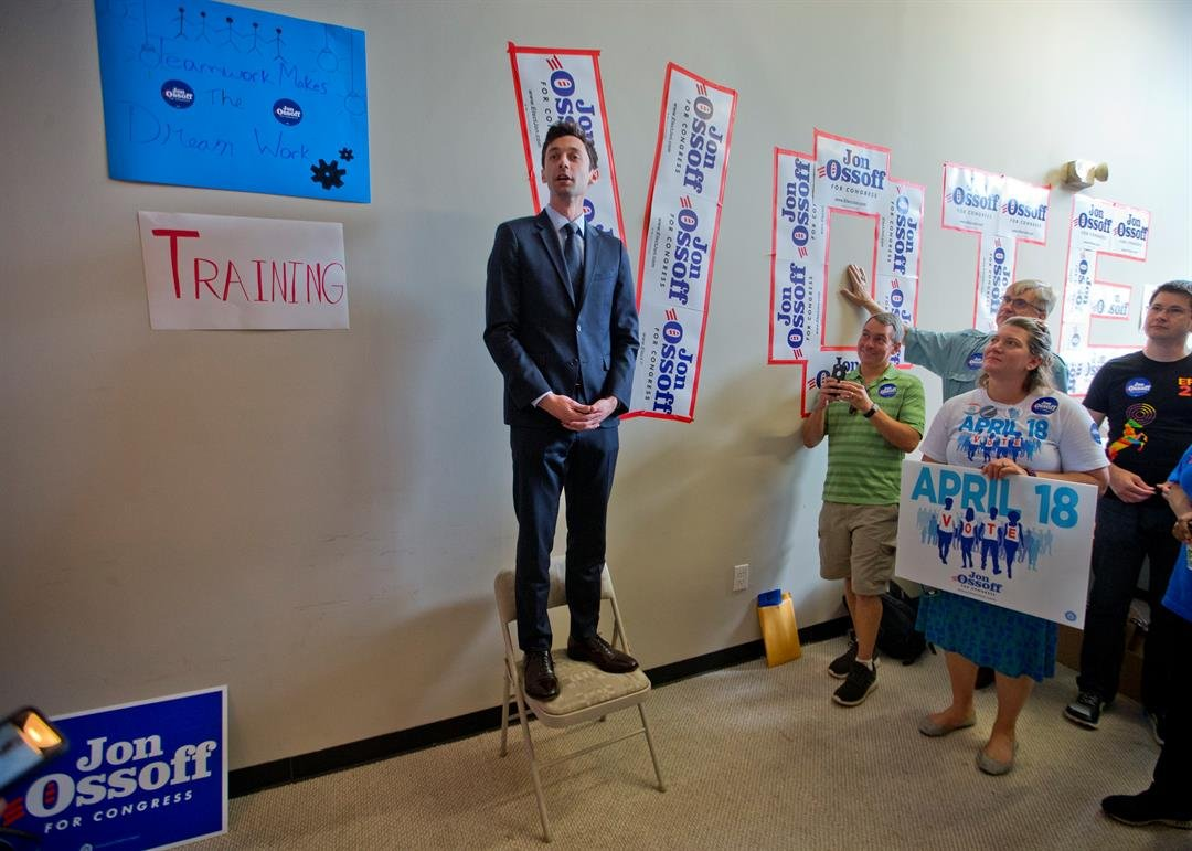 Democratic candidate for Georgia's Sixth Congressional Seat Jon Ossoff talks with reporters at a campaign field office Tuesday, April 18, 2017, in Marietta, Ga. (AP Photo/John Bazemore)