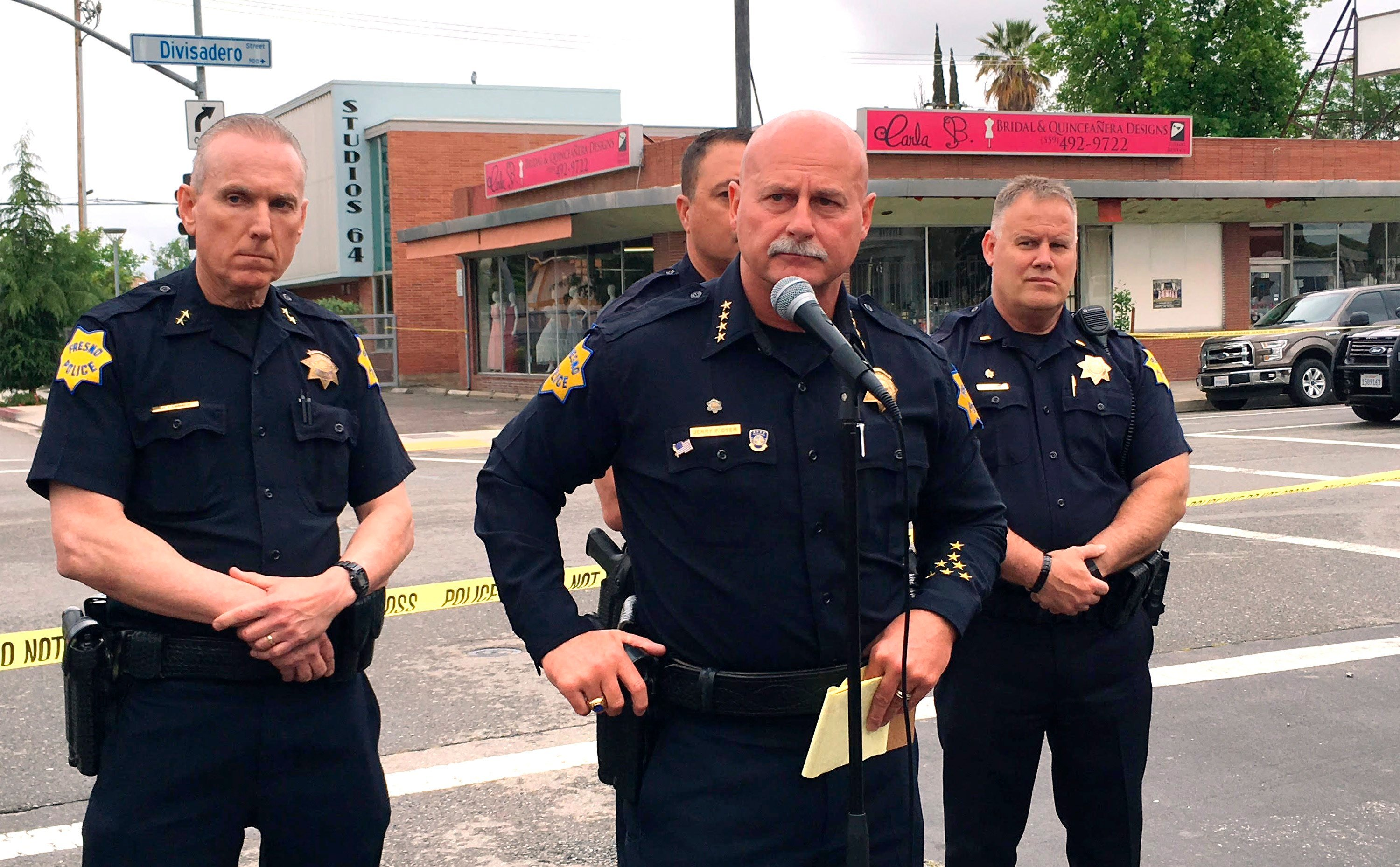 Fresno police chief Jerry Dyer, front, briefs reporters in Fresno, Calif., after a shooting Tuesday, April 18, 2017. (AP Photo/Scott Smith)