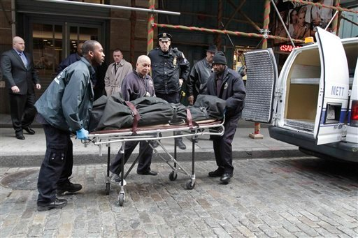 Medical examiner staff remove the body of Mark Madoff from the apartment building in which he lived, Saturday, Dec. 11, 2010 in the Soho neighborhood of New York.