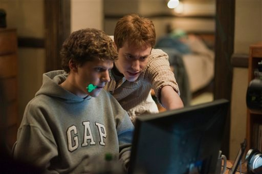 """In this publicity image released by Columbia Pictures, Jesse Eisenberg, left, and Joseph Mazzello are shown in a scene from """"The Social Network.""""  (AP Photo/Columbia Pictures, Merrick Morton)"""