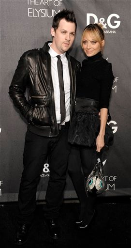 FILE - In this Dec. 15, 2008 file photo, Joel Madden, left, and his wife Nicole Richie arrive at the opening of the D&G flagship boutique in Los Angeles. (AP Photo/Chris Pizzello, File)