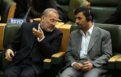 July, 29, 2008 file photo: Iranian President Mahmoud Ahmadinejad listens to his Foreign Minister Manouchehr Mottaki, during the inaugural ceremony of the 15th Non-Aligned Movement Foreign Ministerial meeting, in Tehran. (AP Photo/Hasan Sarbakhshian, File)