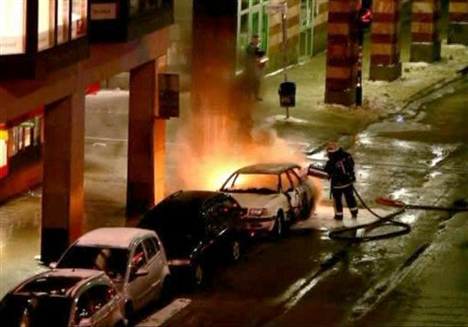 In this image from video, showing emergency services as they attend the scene after a car exploded in the center of Stockholm on Saturday Dec. 11, 2010.