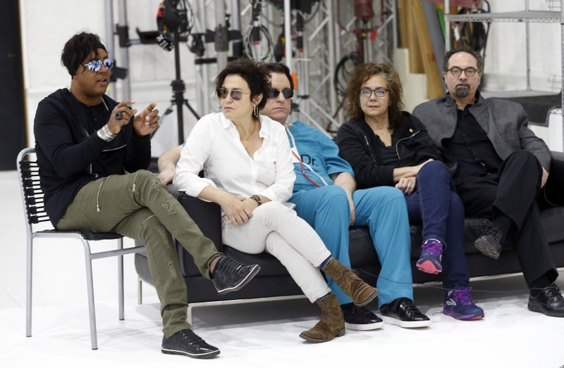 Bassist BrownMark, left, answers a question as the original members of Prince's 1980's band, The Revolution, from second left, guitarist Wendy Melvoin, keyboarders Matt Fink and Lisa Coleman and drummer Bobby Z, look on during an interview.