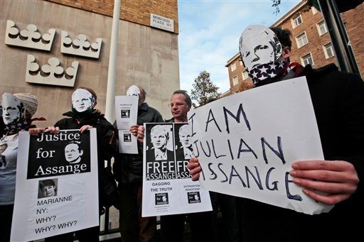 Supporters of WikiLeaks founder Julian Assange, some wearing masks depicting him and holding placards participate at a demonstration outside the Swedish Embassy In central London, Dec. 13, 2010. (AP Photo/Lefteris Pitarakis)