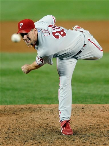 This Sept. 9, 2009, file photo shows Philadelphia Phillies starter Cliff Lee delivering a pitch against the Washington Nationals during the third inning of a baseball game, in Washington.