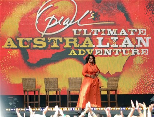 American talk show host Oprah Winfrey is greeted by fans during the filming of Oprah's Ultimate Australian Adventure at the Sydney Opera House in Sydney, Australia, Tuesday, Dec. 14, 2010.