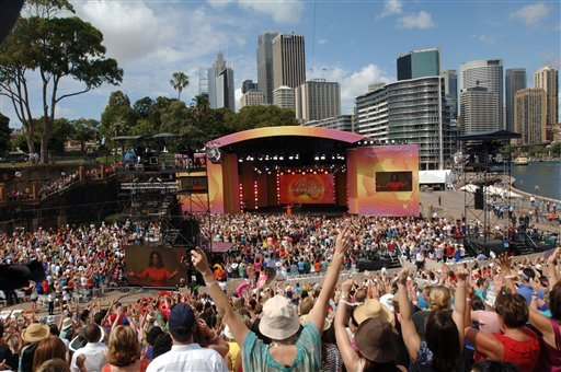 Thousands of fans cheer as American talk show host Oprah Winfrey walks on stage at the Sydney Opera House during the filming of Oprah's Ultimate Australian Adventure.