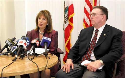 California Rep. Jackie Speier, left, and San Bruno Mayor Jim Ruane, right, speaks during a news conference about the National Transportation Safety Board report of the deadly San Bruno gas line disaster in San Mateo, Calif., on Tuesday, Dec. 14, 2010.
