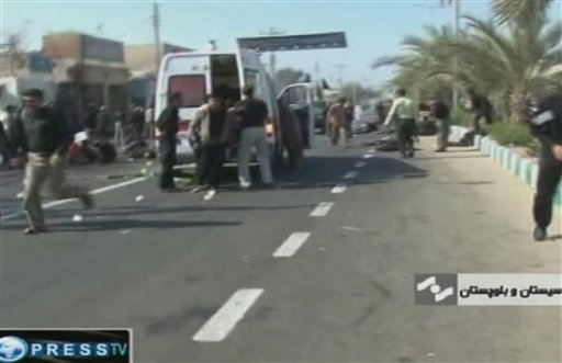 An ambulance attends the scene of a bomb blast in this image taken from TV, in Chahbahar Iran Wednesday Dec. 15, 2010. (AP Photo/Press TV)