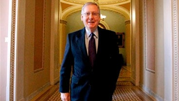 Senate Minority Leader Mitch McConnell of Ky., walks on Capitol Hill in Washington Wednesday, Dec. 15, 2010. (AP Photo)