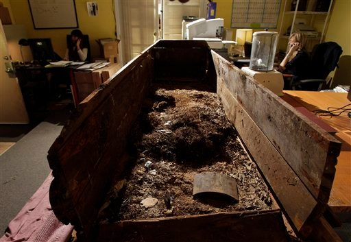 This file photo taken Wednesday, Dec. 1, 2010, shows the wooden coffin in which John F. Kennedy's assassin, Lee Harvey Oswald, was buried in, seen at the Nate D. Sanders Auctions in Los Angeles.