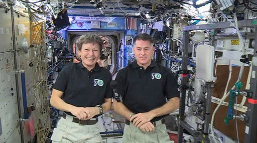 In this image made from video provided by NASA, U.S. astronauts Peggy Whitson, left, and Shane Kimbrough speak from the International Space Station during an interview Jan. 3, 2017. (NASA via AP)