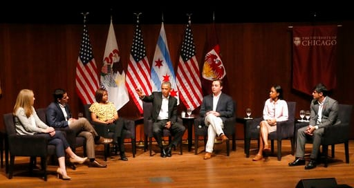 Former President Barack Obama, center, hosts a conversation on civic engagement and community organizing, Monday, April 24, 2017, at the University of Chicago in Chicago. (AP Photo/Charles Rex Arbogast)