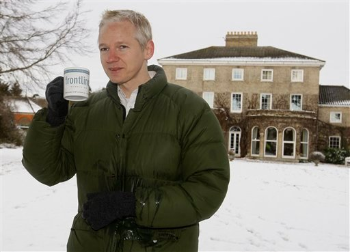 Julian Assange head of WikiLeaks takes a drink during a press conference at the home of Frontline Club founding member Vaughan Smith, at Bungay, England, Friday, Dec. 17, 2010. (AP Photo/Kirsty Wigglesworth)