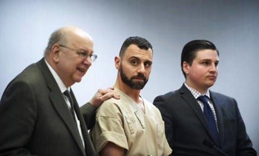 Richard Dabate, center, appears with attorneys Hubie Santos, left, and Trent LaLima, right, while being arraigned, in Rockville Superior Court in Vernon, Conn.