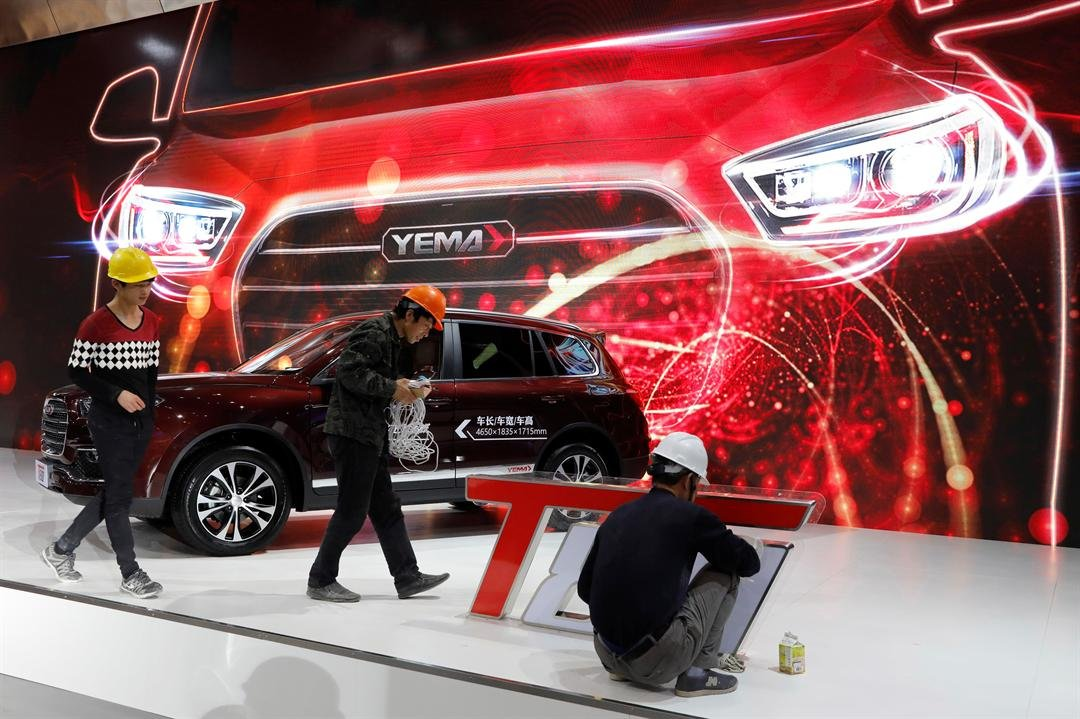 Workers prepare for the Auto Shanghai 2017 show at the National Exhibition and Convention Center in Shanghai, China, Tuesday, April 18, 2017. (AP Photo/Ng Han Guan)