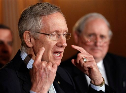 "Senate Majority Leader Sen. Harry Reid, D-Nev., left, with Sen. Carl Levin, D-Mich., speaks at a news conference about the ""Don't Ask Don't Tell"" bill during an unusual Saturday session on Capitol Hill in Washington Saturday, Dec. 18, 2010. (AP)"