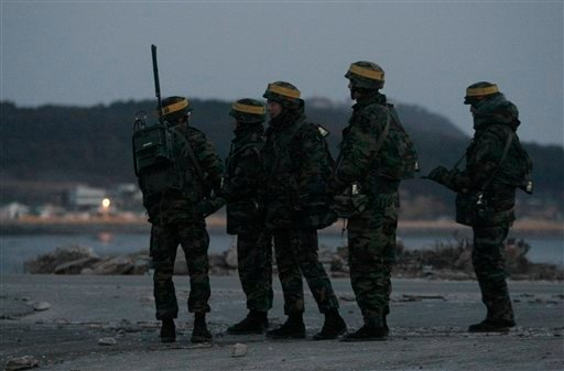 South Korean marines wait their other soldiers to return their base after their patrol along on Yeonpyeong island, South Korea, Saturday, Dec. 18, 2010. (AP Photo/Ahn Young-joon, Pool)