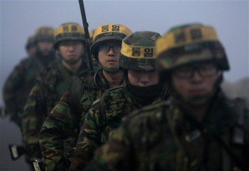 South Korean marines patrol on Yeonpyeong island, South Korea, Sunday, Dec. 19, 2010.