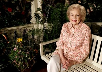 FILE - In this June 9, 2010 file photo, actress Betty White poses for a portrait on the set of the television show 'Hot in Cleveland' in Studio City section of Los Angeles.