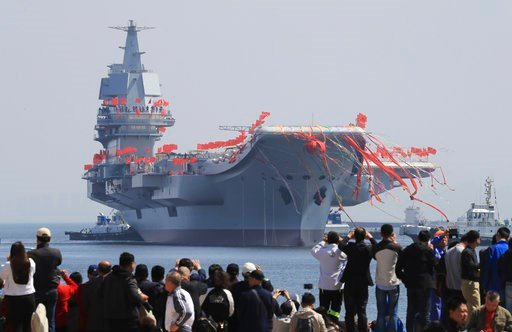The Liaoning, Chinese first domestically built aircraft carrier, starts to sail during the launching ceremony in Dalian, China on April 26, 2017.
