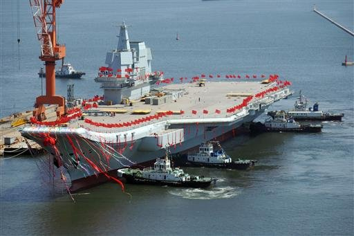 China's first domestically built aircraft carrier, the Type 001A, takes water at Dalian Port in Dalian city, northeast China's Liaoning province, 26 April 2017.
