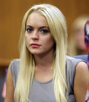 FILE - In this July 20, 2010 file photo, Lindsay Lohan is shown in court in Beverly Hills, Calif. Lohan is being investigated for possible misdemeanor battery against a female staffer at a rehab facility where she is receiving treatment.