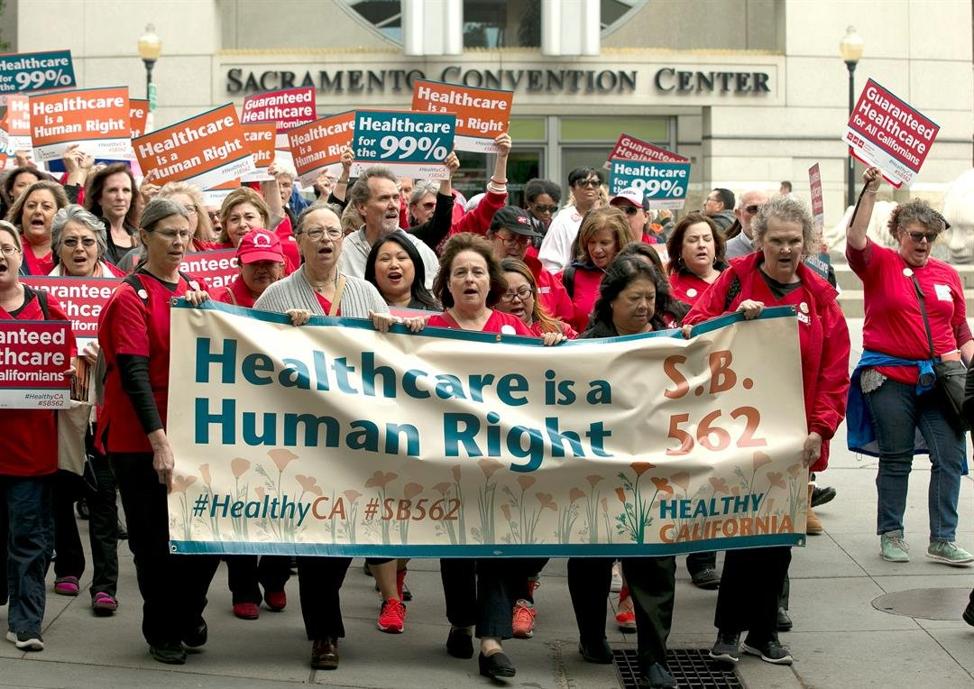 Supporters of single-payer health care march to the Capitol Wednesday, April 26, 2017, in Sacramento, Calif. (AP Photo/Rich Pedroncelli)