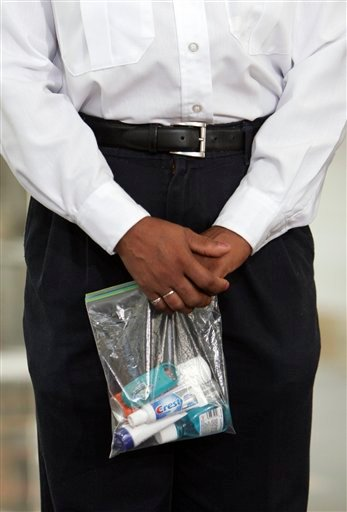 In this Sept. 25, 2006 file photo, a TSA security official holds a bag of liquids and gels.
