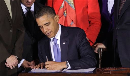 President Barack Obama signs the Don't Ask, Don't Tell Repeal Act of 2010, Wednesday, Dec. 22, 2010, at the Interior Department in Washington. (AP Photo/Pablo Martinez Monsivais)