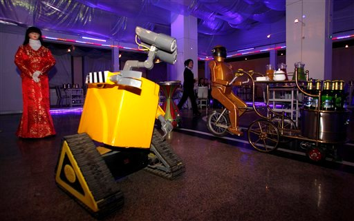 More than a dozen robots operate in the restaurant as entertainers, servers, greeters and receptionists. Each robot has a motion sensor that tells it to stop when someone is in its path so customers can reach for dishes they want.