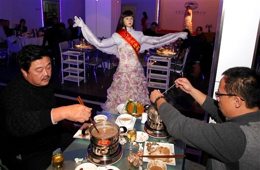 In this Dec. 14, 2010 file photo, a robot entertains customers at a restaurant in Jinan in eastern China's Shandong province.