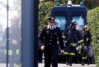 Carabinieri paramilitary police officers and firefighters are seen inside the compound of the Swiss Embassy in Rome, Thursday, Dec. 23, 2010.