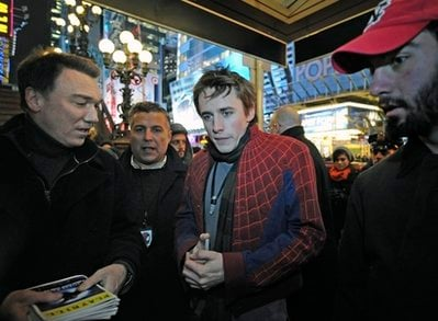 Reeve Carney, center, who plays Spider-man in the theatrical version 'Spider-man Turn off the Dark' is seen outside the Foxwoods Theatre in Times Square with Patrick Page, left, who plays The Green Goblin, Wednesday, Dec . 22, 2010, in New York.