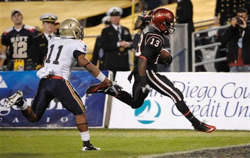San Diego State's Ronnie Hillman, right, outruns Navy's Kwesi Mitchell for a 22-yard touchdown in the first quarter of the Poinsettia Bowl fotball game in San Diego, Thursday, Dec. 23, 2010. (AP Photo/Denis Poroy)