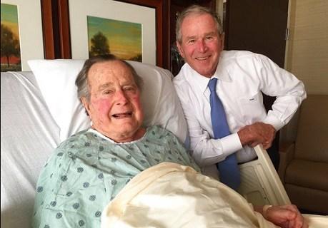 Former President George H.W. Bush, left, posing with his son former President George W. Bush at Houston Methodist Hospital.