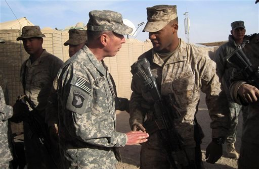 Gen. David Petraeus, left, top U.S. and NATO commander in Afghanistan, meets US marines during his visit to Marjah, Afghanistan, Saturday, Dec. 25, 2010. (AP Photo/Elena Becatoros)
