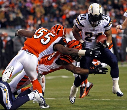 San Diego Chargers running back Ryan Mathews (24) is tackled short of the goal line by Cincinnati Bengals linebacker Michael Johnson, center, and linebacker Keith Rivers (55) in the first half of an NFL football game, Dec. 26, 2010. (AP Photo/Ed Reinke)