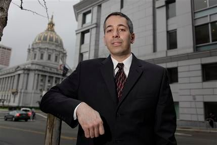 In this Dec. 22, 2010 photo, attorney Daniel Balsam, who hates spam so much that he launched a Website Danhatesspam.com, poses outside in San Francisco. (AP Photo/Eric Risberg)