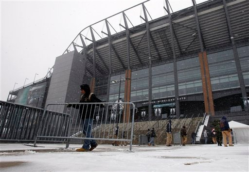 Work crews remove barriers at Lincoln Financial Field, home of the Philadelphia Eagles, Dec. 26, 2010. The Eagles game scheduled for Sunday evening against the Minnesota Vikings was postponed until Tuesday due to wintry weather. (AP Photo/Matt Slocum)